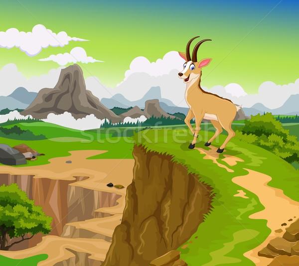funny chamois cartoon with beauty cliff mountain landscape background Stock photo © jawa123