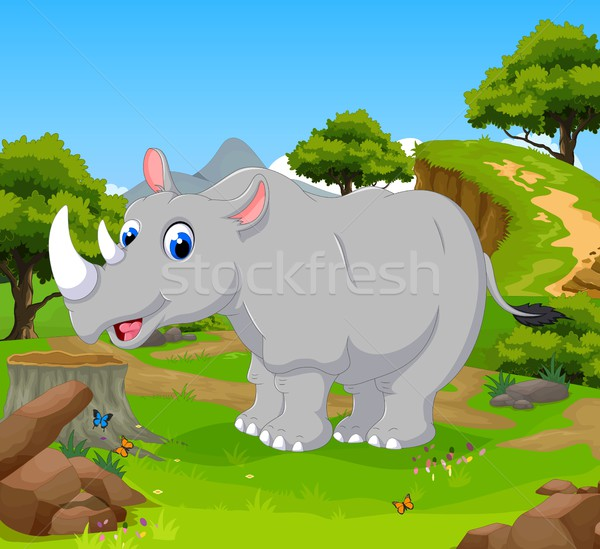 funny rhino cartoon in the jungle with landscape background Stock photo © jawa123
