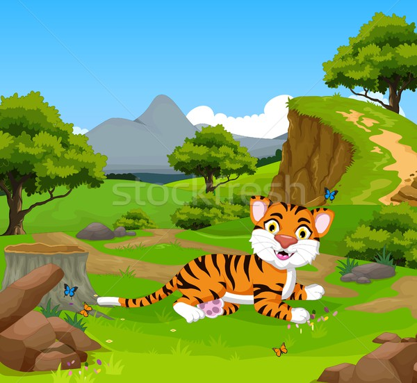 funny baby tiger cartoon in the jungle with landscape background Stock photo © jawa123
