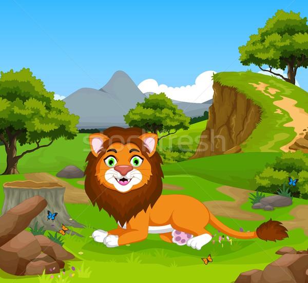 funny lion cartoon sitting in the jungle Stock photo © jawa123