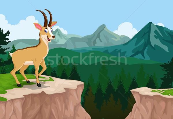 funny chamois cartoon with mountain cliff landscape background Stock photo © jawa123