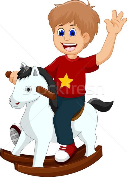 Drôle peu garçon cartoon jouer cheval à bascule Photo stock © jawa123
