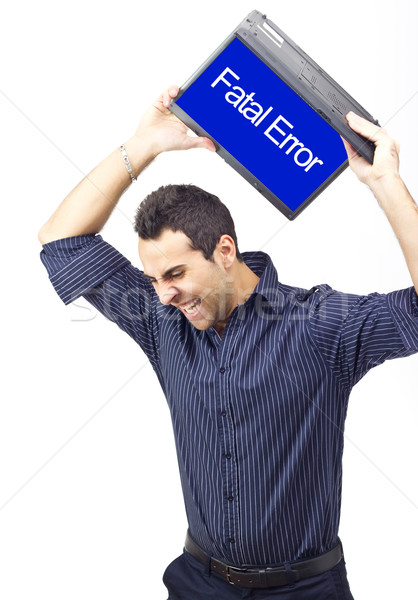 Man throwing laptop because of a system error Stock photo © jaycriss