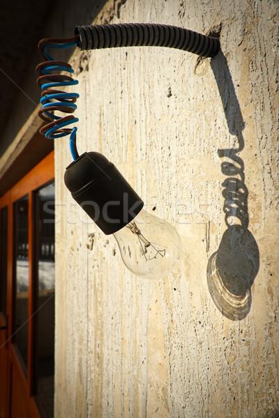 Akasztás átlátszó üveg villanykörte befejezetlen építkezés Stock fotó © jaycriss