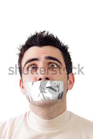 Scared young man having gray duct tape on his mouth Stock photo © jaycriss