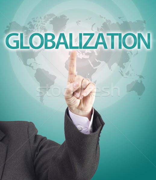 Homem de negócios mão indicação globalização palavra mapa do mundo Foto stock © jaycriss