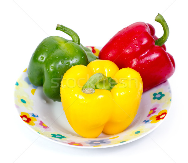 Green red and yellow paprika(capsicum) on plate Stock photo © jaycriss
