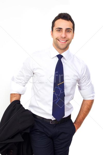 Jeunes souriant homme d'affaires permanent main Photo stock © jaycriss