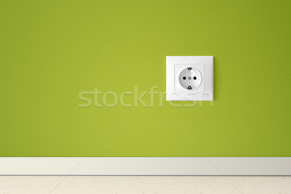Green wall with european electric outlet Stock photo © jaycriss