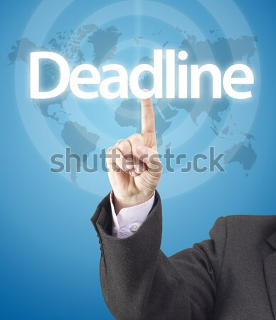 Homme d'affaires date limite mot bleu carte du monde Photo stock © jaycriss
