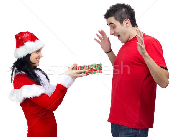 подарок Дед Мороз красивая женщина предлагающий молодые счастливым Сток-фото © jaycriss
