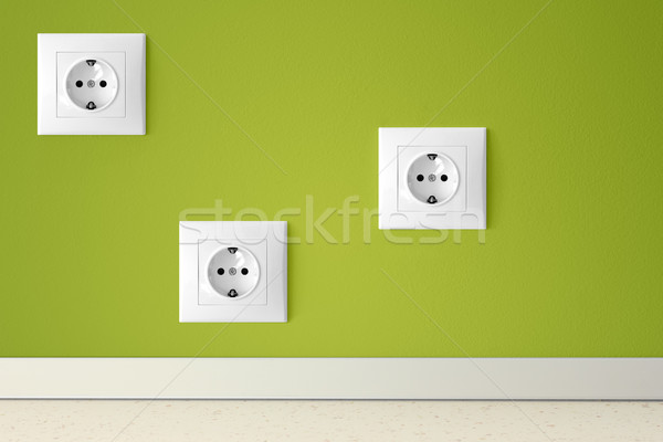 Green wall with three european electric outlets Stock photo © jaycriss