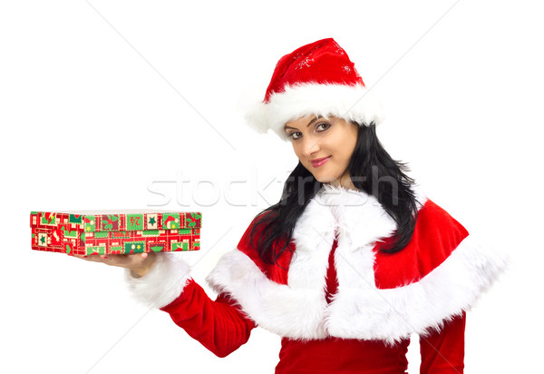 Beautiful woman dressed in Santa Claus holding a gift Stock photo © jaycriss