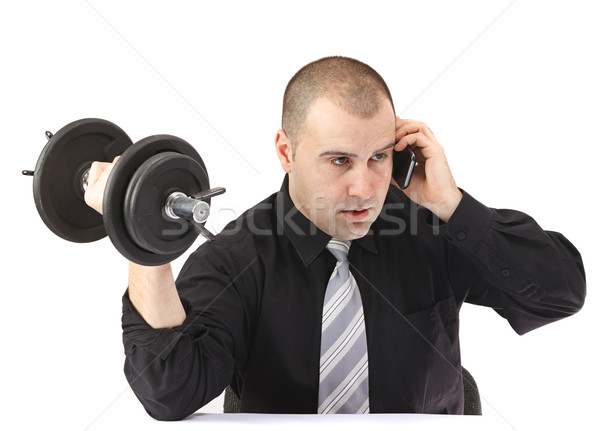 Stock photo: Adult business man on the phone doing fitness at work