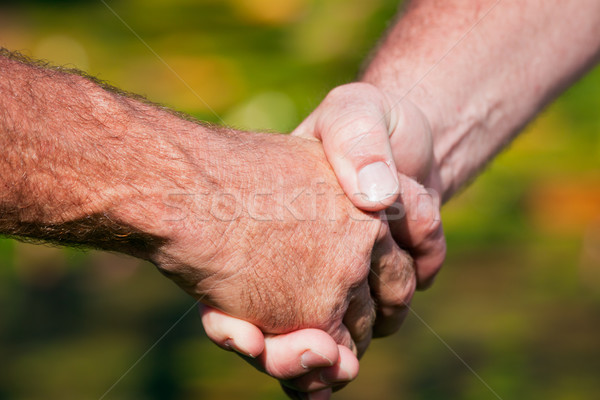 Firm handshake between two men Stock photo © jaykayl