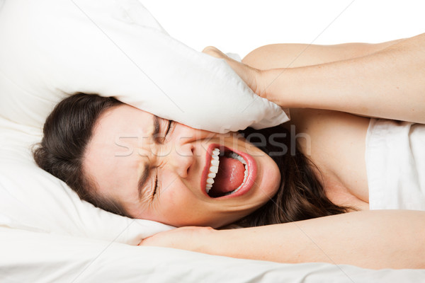 Frustrated woman trying to sleep Stock photo © jaykayl