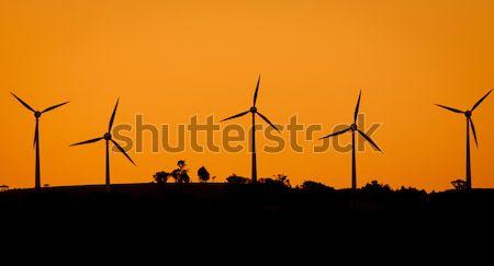 Parque eólico pôr do sol rural Austrália céu natureza Foto stock © jaykayl