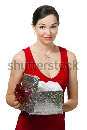 Disappointed woman holding a gift Stock photo © jaykayl