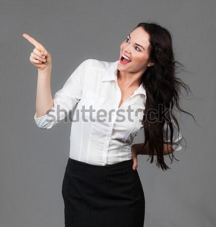 美しい ビジネス女性 ポインティング コピースペース 小さな 笑みを浮かべて ストックフォト © jaykayl