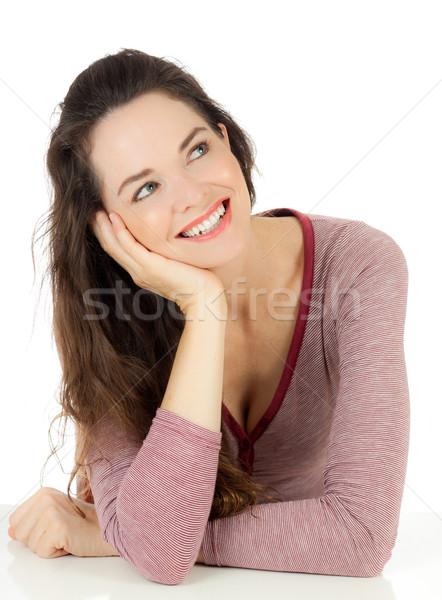 Mooie jonge vrouw glimlachend aantrekkelijk naar exemplaar ruimte Stockfoto © jaykayl