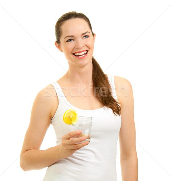 Mooie vrouw lachend glas water geïsoleerd Stockfoto © jaykayl