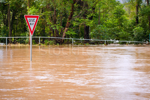 Very flooded road and give way sign Stock photo © jaykayl