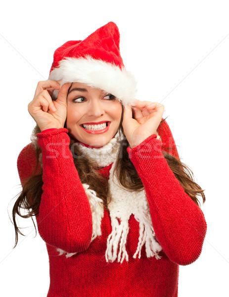 Atrakcyjna kobieta na zewnątrz Święty mikołaj hat atrakcyjny młoda kobieta Zdjęcia stock © jaykayl