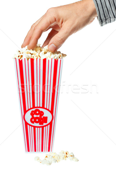 Hand grabbing popcorn out of container Stock photo © jaykayl