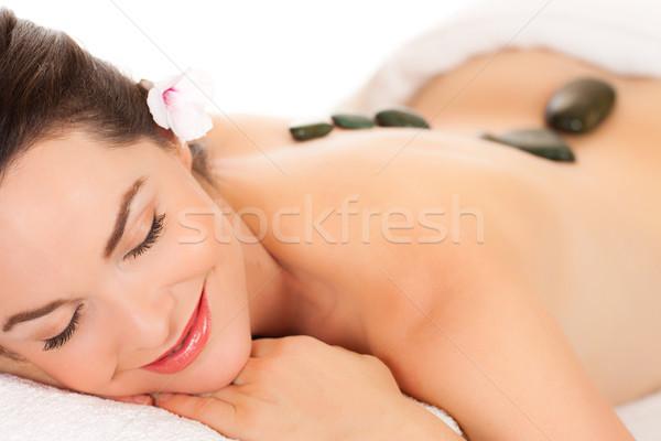 Aantrekkelijk jonge vrouw hot steen massage geïsoleerd Stockfoto © jaykayl