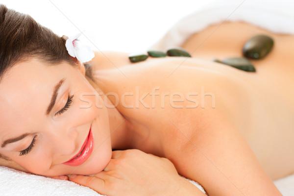 Piękna kobieta hot kamień masażu odizolowany portret Zdjęcia stock © jaykayl
