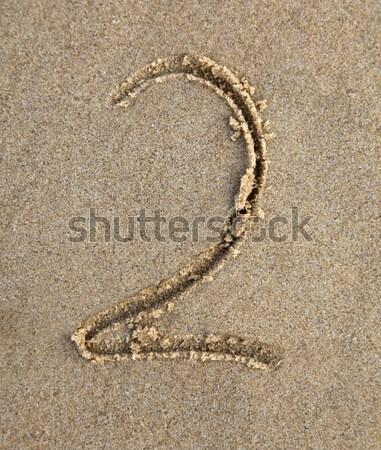 Altı yazılı kum plaj numara Stok fotoğraf © jeayesy
