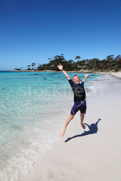 Boy at Binalong Bay - Bay of Fires - Tasmania Australia Stock photo © jeayesy