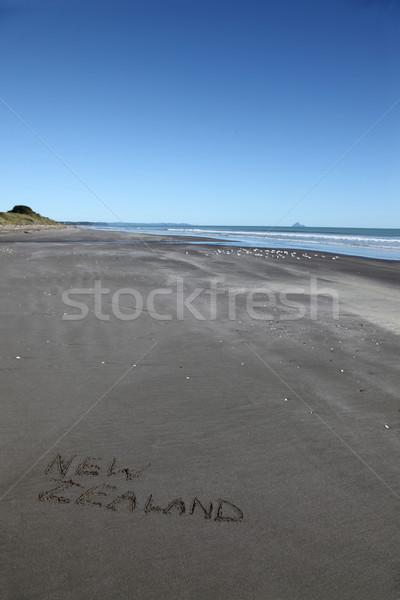 Nova Zelândia praia escrito areia norte ilha Foto stock © jeayesy