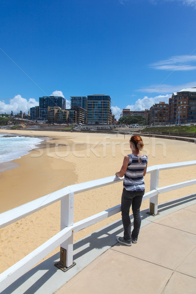 Newcastle Beach - Woman enjoying the view. Stock photo © jeayesy
