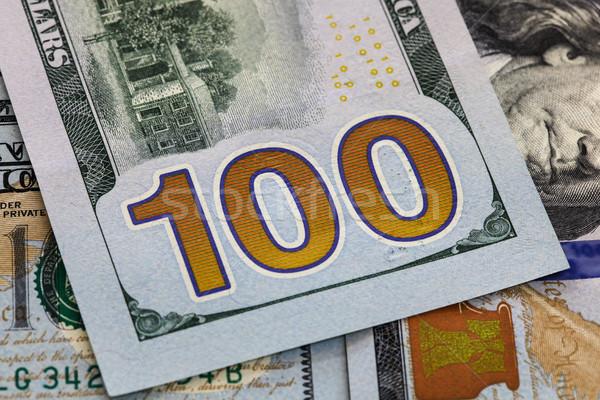 Egy száz dollár jegyzet közelkép USA Stock fotó © jeayesy