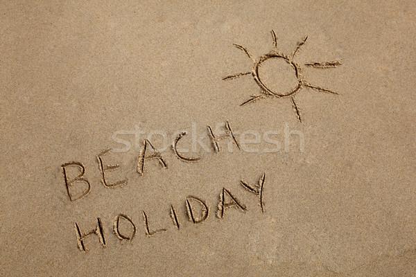 書かれた 砂 太陽 シンボル ビーチ ストックフォト © jeayesy