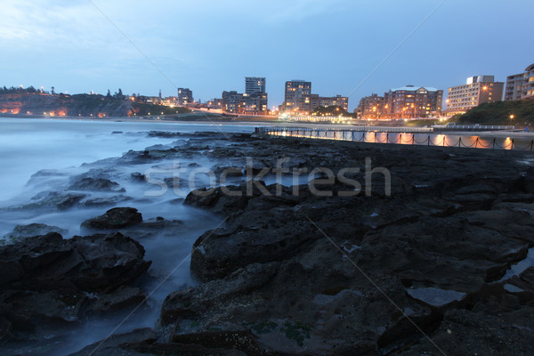 Newcastle tengerpart Ausztrália naplemente második tájkép Stock fotó © jeayesy