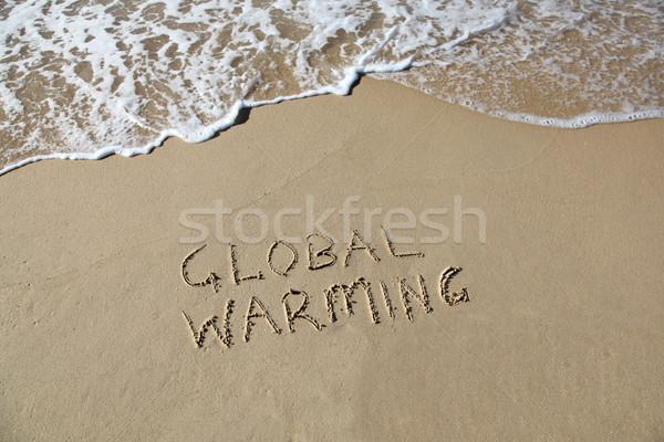 Opwarming van de aarde geschreven zand strand golf Stockfoto © jeayesy