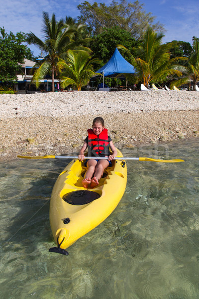 Young girl kayaking in Vanuatu Stock photo © jeayesy