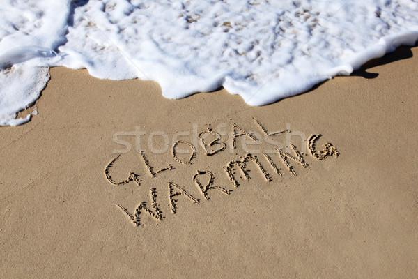 Küresel isınma yazılı kum plaj dalga Stok fotoğraf © jeayesy