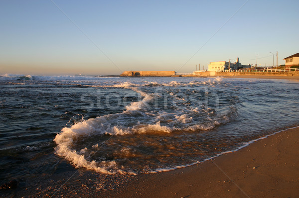 Kora reggel Newcastle Ausztrália hullám tekercsek part Stock fotó © jeayesy