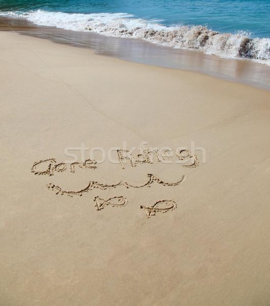 Pesca escrito arena agua mar Foto stock © jeayesy