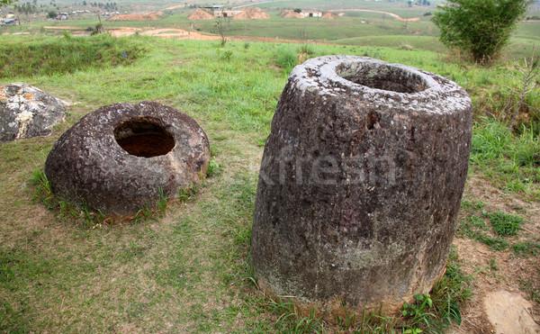 Laos pedra em torno de desconhecido usado Foto stock © jeayesy