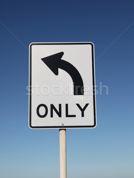 Left Turn Only Sign with blue sky background Stock photo © jeayesy