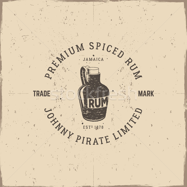 Stock photo: Vintage handcrafted pirate rum emblem, alcohol label, logo. Isolated on a scratched paper background
