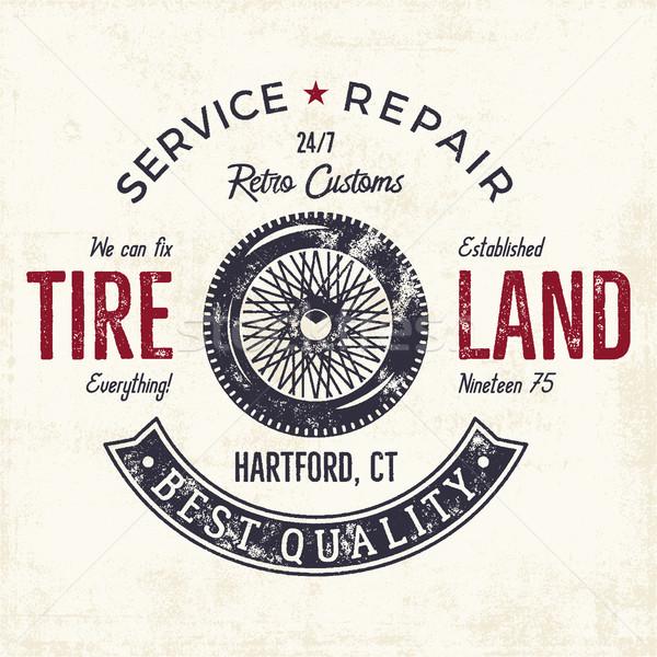 Vintage label design  Tire service emblem in monochrome retro style