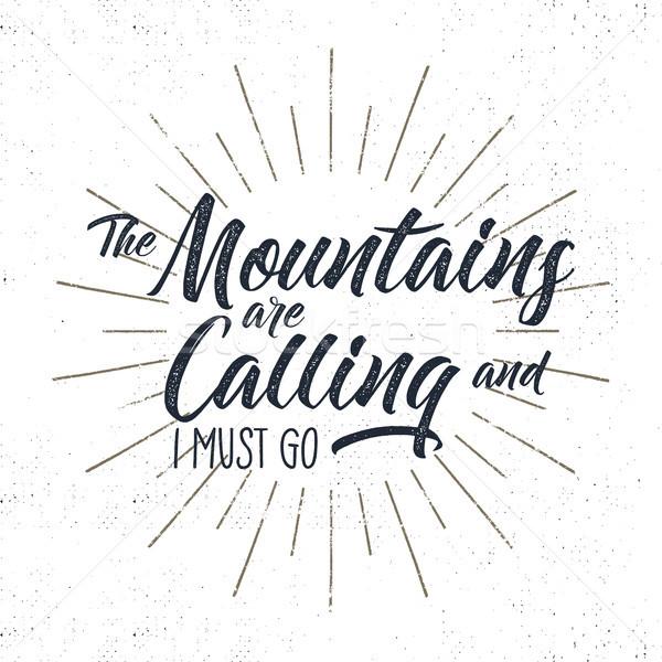 Hand drawn adventure typography sign. Mountains calling illustration. Typographic design with sun bu Stock photo © JeksonGraphics
