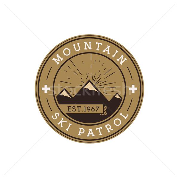 Ski Patrol Round Label. Vintage Mountain winter sports explorer badge. Outdoor adventure logo design Stock photo © JeksonGraphics