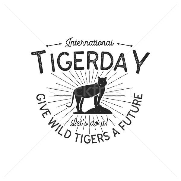 International tiger day emblem. Wild animal badge design. Vintage hand drawn typography logo of tige Stock photo © JeksonGraphics