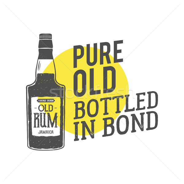 Vintage handcrafted label, emblem with old rum bottle and vector slogan - pure old bottled in bond.  Stock photo © JeksonGraphics